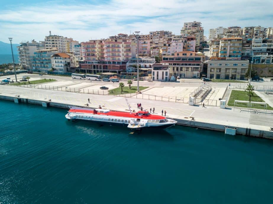 Photo of a red and white ferry sitting in Saranda port Albania travel restrictions: Travelling Albania in 2021
